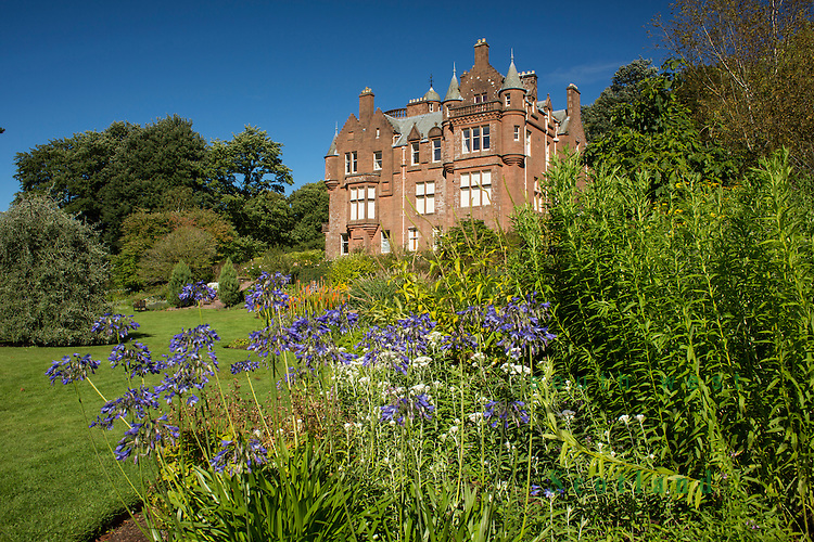 Threave Gardens owned by the National Trust for Scotland. Looking up Threave House a fine Scottish Baronial style house, within the gardens, which was built by the Gordon family in 1872.