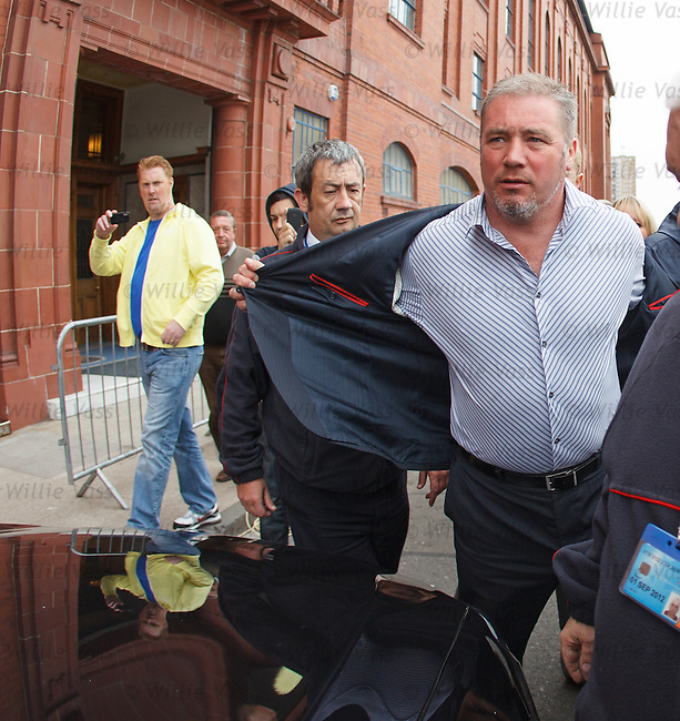 Rangers manager Ally McCoist leaves Ibrox amidst press speculation over his future at the club