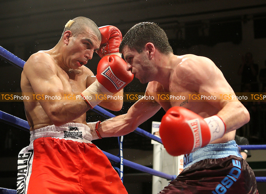 Matthew Marsh (West Ham, claret shorts) defeats Esham Pickering (Newark, red shorts) in a Super-Bantamweight contest for the British Title at York Hall Bethnal Green, promoted by Hennessy Sports - 27/06/08 - MANDATORY CREDIT: Gavin Ellis/TGSPHOTO - Self billing applies where appropriate - Tel: 0845 094 6026.