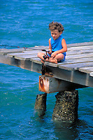 Young boy fishing on a pier, hobbies, dock, child, children. Sterling or Eric Owen. Hawaii.