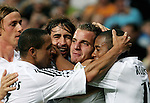 Real Madrid's Roberto Soladado, centre, is congratulated by teammates Guti, Roberto Carlos, Raul and Robinho after scoring his side winning goal during their Champions League match at Santiago Bernabeu Stadium in Madrid, Wednesday 28 September, 2005. (Photo / Alvaro Hernandez)