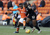 Blackpool's Marc Bola battles with Barnsley's Dimitri Cavare<br /> <br /> Photographer Rich Linley/CameraSport<br /> <br /> The EFL Sky Bet League One - Blackpool v Barnsley - Saturday 22nd December 2018 - Bloomfield Road - Blackpool<br /> <br /> World Copyright &copy; 2018 CameraSport. All rights reserved. 43 Linden Ave. Countesthorpe. Leicester. England. LE8 5PG - Tel: +44 (0) 116 277 4147 - admin@camerasport.com - www.camerasport.com