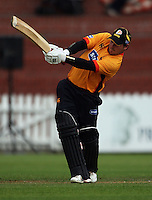 BJ Crook slams the ball into the RA Vance Stand for six during the State Shield cricket match between the Wellington Firebirds and Central Stags at Allied Prime Basin Reserve, Wellington, New Zealand on Sunday, 11 January 2009. Photo: Dave Lintott / lintottphoto.co.nz