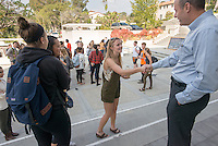 Oxy President Jonathan Veitch meets students. Occidental College students march in a rally organized by Fossil Free Occidental on Nov. 14, 2014. The group hopes to end Oxy's reliance on fossil fuels by freezing all investments in the 200 largest fossil-fuel companies (measured by their proven carbon reserves in oil, gas or coal) and over the next five to ten years sell the stock in these same companies, and then reinvest 5%, at minimum, of the divested portfolio in socially responsible investments. (Photo by Marc Campos, Occidental College Photographer)