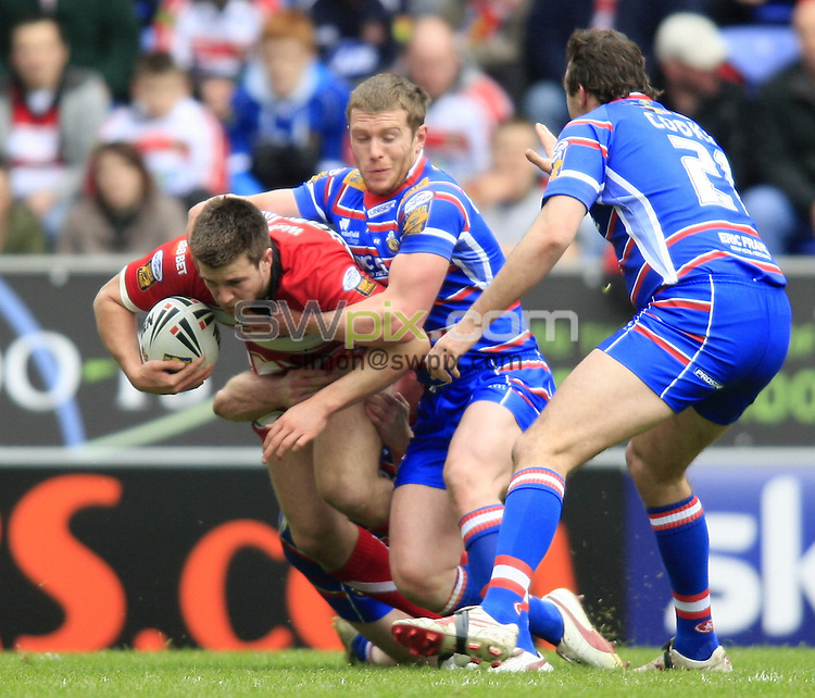 Pix: Chris Mangnall /SWPix.com, Rugby League, Super League. 05/04/10 Wigan Warriors v Wakefield Trinity Wildcats....picture copyright>>Simon Wilkinson>>07811267 706>>....Wigan's Darrell Goulding tackled by Wakefield's Matt Blaymire and Danny Kirmond