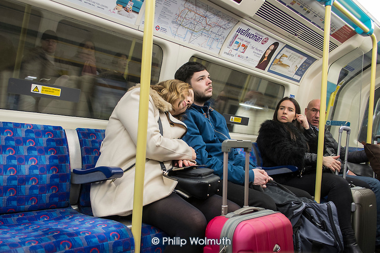 Passengers on a London undergraound train.
