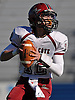 Glen Cove quarterback No. 12 Mike Payton looks downfield during the first quarter of the Nassau County varsity football Conference III final against Plainedge at Hofstra University on Saturday, Nov. 21, 2015.<br /> <br /> James Escher