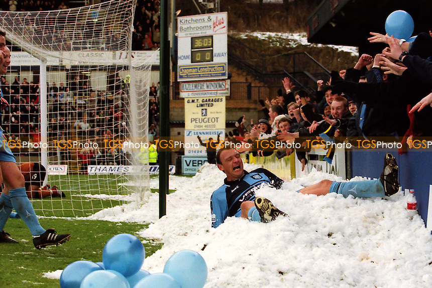 Andy Rammell scores and dives into the snow to celebrate scoring Wycombe's opening goal during Wycombe Wanderers vs Wolverhampton Wanderers, FA Cup Football at Adams Park on 27th January 2001