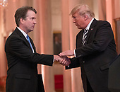 United States President Donald J. Trump shakes hands with Associate Justice of the US Supreme Court Brett Kavanaugh as he hosts a ceremonial swearing-in ceremony for Kavanaugh in the East Room of the White House in Washington, DC on Monday, October 8, 2018.  Kavanaugh formally took the oath on Saturday, hours after he was confirmed by the US Senate.  <br /> Credit: Ron Sachs / CNP<br /> (RESTRICTION: NO New York or New Jersey Newspapers or newspapers within a 75 mile radius of New York City)