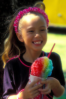 Young girl eating shave ice treat