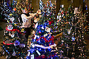 04/12/14<br /> <br /> Hannah Nutter, 22, decorates one of the trees.<br /> <br /> The country's largest Christmas tree festival opened last night in Melton Mowbray St Mary's Church, Melton Mowbray, Leicestershire. Visitors can view the 905 trees which range from full size to miniature trees every day until 3pm on Tuesday, when the businesses, clubs and people in the town who made the trees will collect them - many of them being walked through the town to be relocated to new sites for the rest of Christmas.<br /> <br /> All the trees are themed, often with funny names. There's an interactive electronic tree, a money tree (photographed) and many trees are decorated with poppies to commemorate the 100 year anniversary of WW1.  <br /> <br /> Hannah Nutter's tree, named 'Pantree', is decorated with pants and knickers.<br /> <br /> <br /> ***ANY UK EDITORIAL PRINT USE WILL ATTRACT A MINIMUM FEE OF &pound;130. THIS IS STRICTLY A MINIMUM. USUAL SPACE-RATES WILL APPLY TO IMAGES THAT WOULD NORMALLY ATTRACT A HIGHER FEE . PRICE FOR WEB USE WILL BE NEGOTIATED SEPARATELY***<br /> <br /> <br /> All Rights Reserved - F Stop Press. www.fstoppress.com. Tel: +44 (0)1335 300098