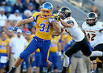 BROOKINGS, SD - SEPTEMBER 20:  Zach Zenner #31 from South Dakota State slips the grasp of Levi Kossow #46 from Wisconsin-Oshkosh in the first half of their game Saturday at Coughlin Alumni Stadium in Brookings. (Photo/Dave Eggen/Inertia)