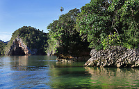 Coastal caves in the Parque Nacional de los Haitises, or Los Haitises National Park, on the North East coast of the Dominican Republic, in the Caribbean. The park was established in 1976 and consists of limestone karst scenery, mountains, subtropical forest and mangrove forests along the coast. Picture by Manuel Cohen