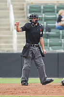 Home plate umpire Derek Gonzales makes a strike call during the South Atlantic League game between the West Virginia Power and the Kannapolis Intimidators at CMC-Northeast Stadium on April 29, 2014 in Kannapolis, North Carolina.  The Intimidators defeated the Power 1-0.  (Brian Westerholt/Four Seam Images)