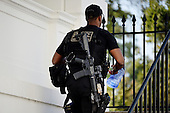 A United States Secret Service agent walks inside the White House October 1 , 2014 in Washington, DC. Julia Pierson, the director of the U.S. Secret Service, resigned Wednesday amid embarrassing new revelations of breaches to the protective cordon around U.S. President Barack Obama. <br /> Credit: Olivier Douliery / Pool via CNP