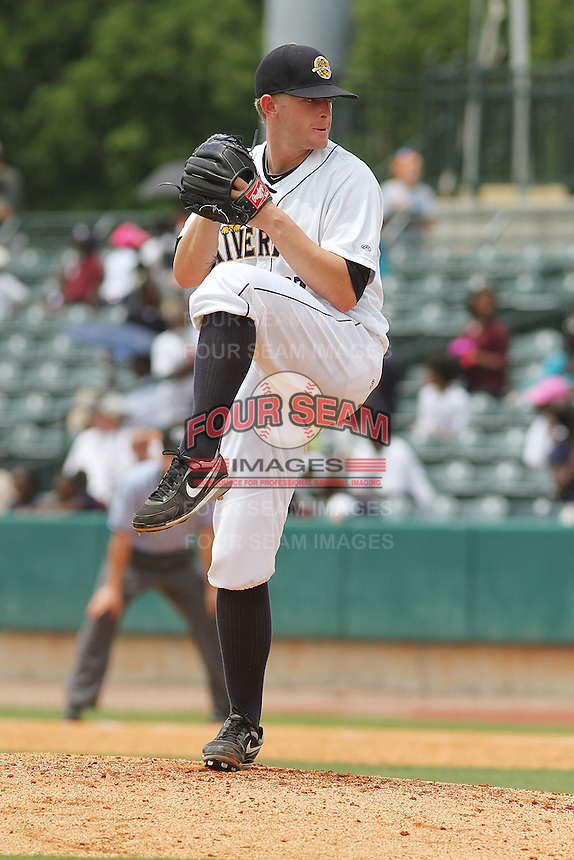 Charleston Riverdogs pitcher Caleb Cotham #27 on the mound during a game against the Savannah Sand Gnats at Joseph P. Riley Jr. Park on May 16, 2012 in Charleston, South Carolina. Charleston defeated Savannah by the score of 14-5. (Robert Gurganus/Four Seam Images)