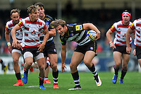 Max Clark of Bath Rugby takes on the Gloucester defence. West Country Challenge Cup match, between Gloucester Rugby and Bath Rugby on September 13, 2015 at the Memorial Stadium in Bristol, England. Photo by: Patrick Khachfe / Onside Images