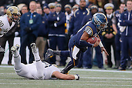 Annapolis, MD - December 28, 2015:     Navy Midshipmen quarterback Keenan Reynolds (19) gets tackled by a Pitt defender during the Military Bowl game between Pitt vs Navy at Navy-Marine Corps Memorial Stadium in Annapolis, MD. (Photo by Elliott Brown/Media Images International)