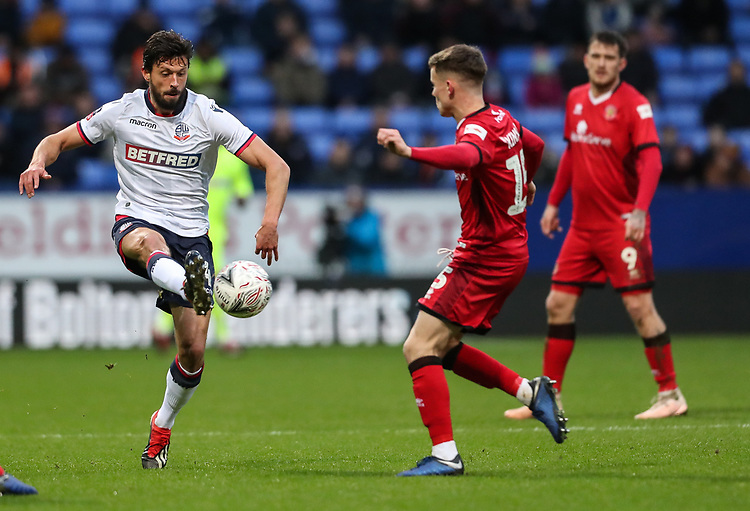 Bolton Wanderers' Jason Lowe competing with Walsall's Liam Kinsella<br /> <br /> Photographer Andrew Kearns/CameraSport<br /> <br /> Emirates FA Cup Third Round - Bolton Wanderers v Walsall - Saturday 5th January 2019 - University of Bolton Stadium - Bolton<br />  <br /> World Copyright © 2019 CameraSport. All rights reserved. 43 Linden Ave. Countesthorpe. Leicester. England. LE8 5PG - Tel: +44 (0) 116 277 4147 - admin@camerasport.com - www.camerasport.com