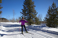 Cross country skier skating down the groomed trails  of the Wind River Mountains in Pinedale Wyoming