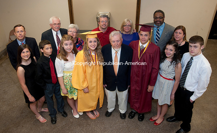 WATERBURY, CT 07 JUNE 2013--060713JS03- 2013 Sacred Heart High School graduates Molly Murphy and George Gomes, center pose with Francis X. Murphy, Sacred Heart Class of '42 as well as other family members that are graduates, or will be graduating, from Sacred Heart. The family legacy includes, front row, from left,Madison Laferrier ('16); Ben Gomes ('17) Ireland Gilmore ('16); Katherine Gomes ('15); and John Murphy ('15). Back row, from left, Todd Murphy ('83); Mike Mansell ('60); Jill Mansell ('61); Mike Mansell ('61); Mike Mansell ('89) Paige Gomes ('85) and Erin Laferriere ('93). The family gathered prior to the 87th Commencement Exercises Friday at the Basilica of The Immaculate Conception in Waterbury.<br /> Jim Shannon Republican American