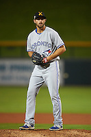 Salt River Rafters pitcher Brady Dragmire (33) gets ready to deliver a pitch during an Arizona Fall League game against the Mesa Solar Sox on October 23, 2015 at Sloan Park in Mesa, Arizona.  Salt River defeated Mesa 5-1.  (Mike Janes/Four Seam Images)