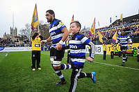 Taulupe Faletau of Bath Rugby, mascot in hand, runs out onto the field. Aviva Premiership match, between Bath Rugby and Saracens on December 3, 2016 at the Recreation Ground in Bath, England. Photo by: Patrick Khachfe / Onside Images