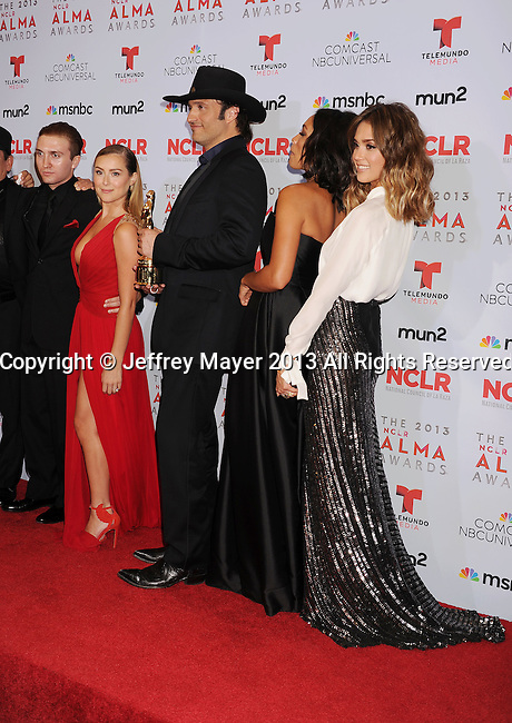 PASADENA, CA- SEPTEMBER 27: (L-R) Actors Daryl Sabara and Alexa Vega, director Robert Rodriguez and actors Rosario Dawson and Jessica Alba pose in the press room at the 2013 NCLA ALMA Awards at Pasadena Civic Auditorium on September 27, 2013 in Pasadena, California.