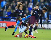 9th February 2019, The John Smith's Stadium, Huddersfield, England; EPL Premier League football, Huddersfield versus Arsenal; Alex Iwobi of Arsenal is tackled by Juninho Bacuna of Huddersfield Town