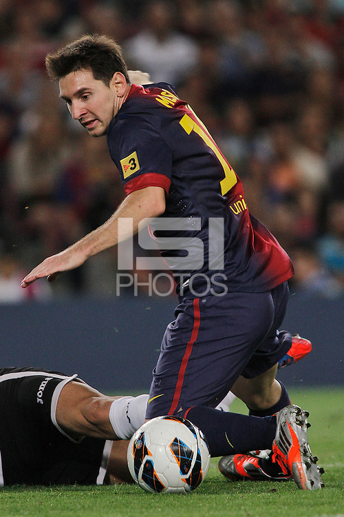02/09/2012 - Liga Football Spain, FC Barcelona vs. Valencia CF Matchday 3 - Lionel Messi, argentinian striker for FC Barcelona, controls the ball while in the ground