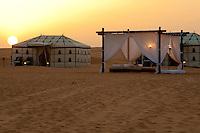 Evening descends on the desert camp