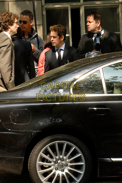 """TOM HOLLANDER.Filming on the set of """"In The Loop"""" (an American / BBC production about Bush & Blair starting a war) on location behind The British Museum, London, england..May 13th, 2008.half length car film movie .CAP/IA.©Ian Allis/Capital Pictures."""
