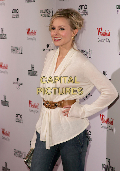 "KRISTEN BELL.L.A. Premiere of ""The Producers"" held at The New Century City AMC 15 Theatre in Century City, California.  .December 12th, 2005.Ref: DVS.half length white blouse hand on hip brown belt.www.capitalpictures.com.sales@capitalpictures.com.Supplied By Capital PIctures"