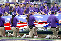SEATTLE, WA - SEPTEMBER 9:  Washington band members hold the American Flag during the singing of the National Anthem before the football game between the Washington Huskies and the Montana Grizzlies on September 09, 2017 at Husky Stadium in Seattle, WA. Washington won 63-7 over Montana.