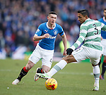 Fraser Aird knocks the ball past Emilio Izaguirre
