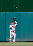 15 June 2016: Washington Nationals outfielder Ben Revere pulls in a fly ball  during a game against the Chicago Cubs at Nationals Park in Washington, DC. The Nationals defeated the Cubs 5-4 in 12 innings to take the rubber match of their 3-game series. Mandatory Credit: Ed Wolfstein Photo *** RAW (NEF) Image File Available ***