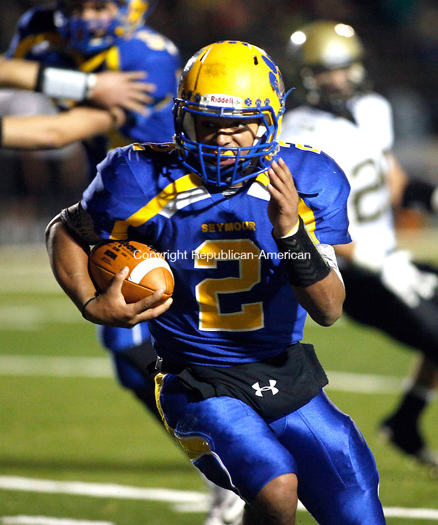 Seymour, CT- 25 November 2015-112515CM04-  Action man---- Seymour's Jaylen Kelley carries the ball during their NVL matchup against Woodland in Seymour on Wednesday.  Seymour would go onto win, 53- 7.    Christopher Massa Republican-American