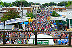 Sept. 22, 2012 - Bellmore, New York U.S. - View from above of the 26th Annual Bellmore Family Street Festival, from elevated train platform of Bellmore Long Island Railroad station (LIRR). The Chamber of Commerce of the Bellmores' white tent with green banner is right behind the center of platform raiiling. More people than the well over 120,000 who attended last year are expected, according to the Festival Coordinator.