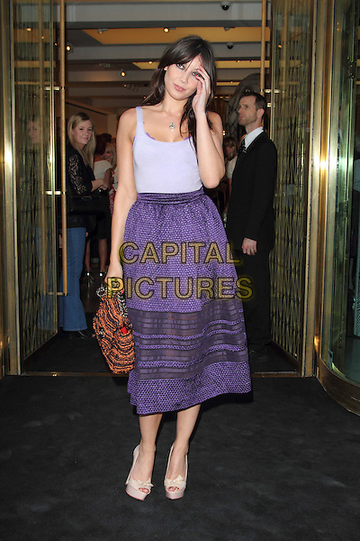 Daisy Lowe .Fashion's Night Out - Vogue Party at Mulberry, New Bond Street, London, England..September 6th 2012.full length purple vest tank top skirt hand arm orange bag purse beige shoes .CAP/ROS.©Steve Ross/Capital Pictures.....