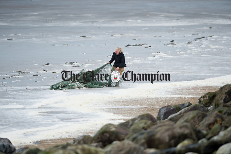 Local man Jim Logan retrieves a net from the sea in Lahinch during Storm Imogen. Photograph by John Kelly.