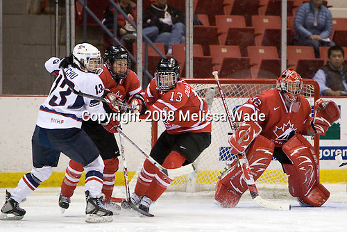 Julie Chu (US - 13), Jennifer Wakefield (Canada - 20), Caroline Ouellette (Canada - 13), Charline Labonte (Canada - 32) - Team USA defeated Team Canada 4-3 (so) to win the 2008 Four Nations Cup on Sunday, November 9, 2008, in the 1980 Rink in Lake Placid, New York.
