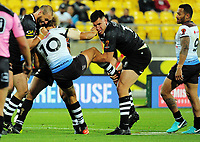 Simon Mannering and Nelson Asofa-Solomona tackle Eloni Vunakece during the 2017 Rugby League World Cup quarterfinal match between New Zealand Kiwis and Fiji at Westpac Stadium in Wellington, New Zealand on Saturday, 18 November 2017. Photo: Mike Moran / lintottphoto.co.nz