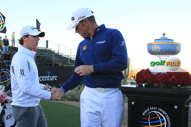 Lee Westwood (ENG) takes the height and shakes hands with  Rory McIlroy (NIR) as they pose for a picture on the first tee on day 5 Sunday semifinal at the WGC - Accenture Match Play Championship,Ritz-Carlton GC, Dove Mountain, Marana, Arisona, USA..22 Feb 2012 - 26 Feb 2012.Picture: Fran Caffrey www.golffile.ie
