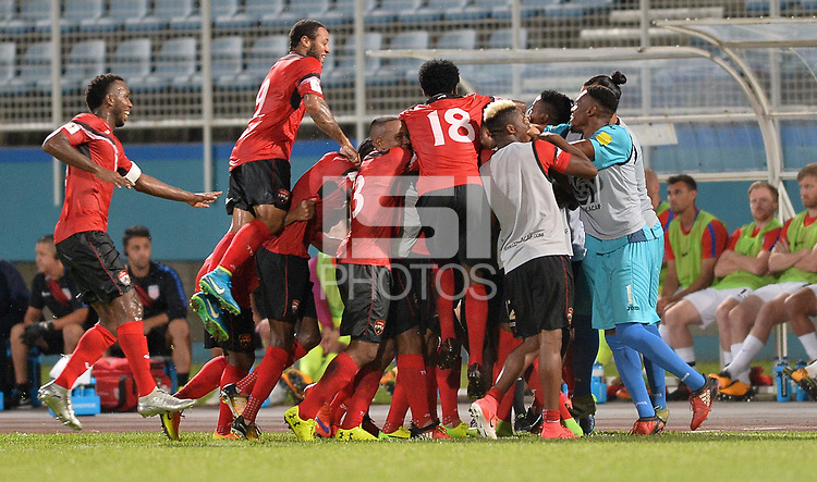 Couva, Trinidad & Tobago - Tuesday Oct. 10, 2017: Trinidad & Tobago score and celebrate during a 2018 FIFA World Cup Qualifier between the men's national teams of the United States (USA) and Trinidad & Tobago (TRI) at Ato Boldon Stadium.