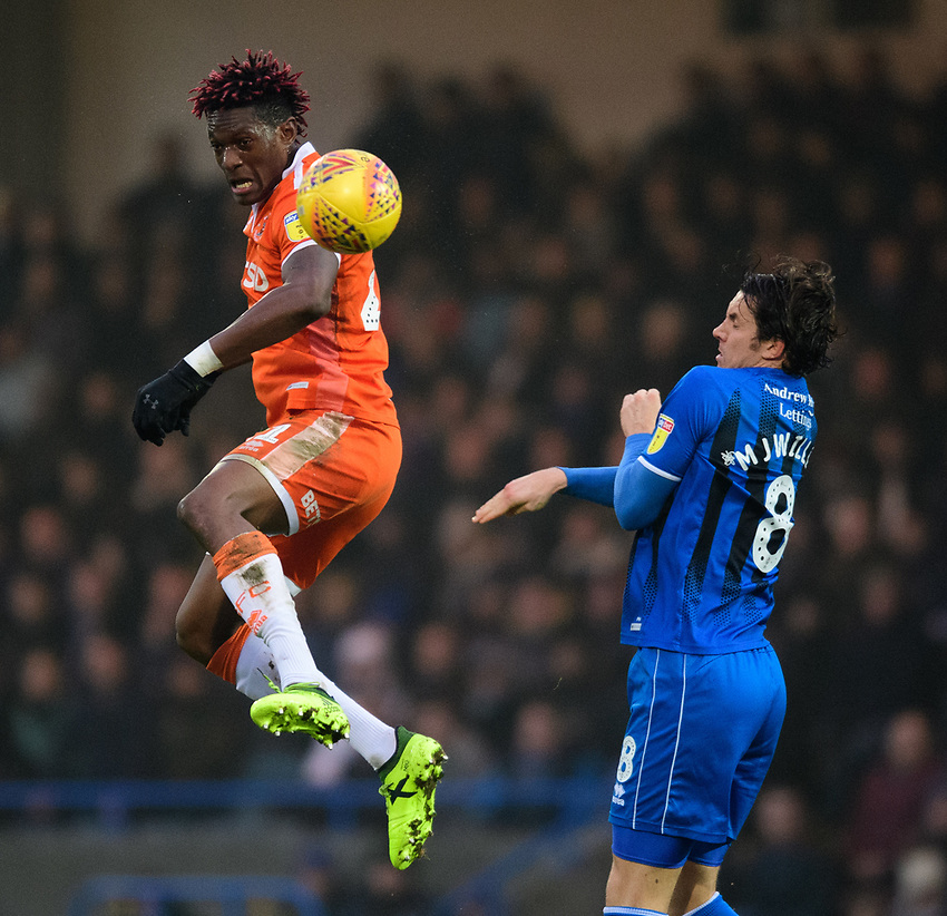 Blackpool's Armand Gnanduillet vies for possession with Rochdale's Jordan Williams<br /> <br /> Photographer Chris Vaughan/CameraSport<br /> <br /> The EFL Sky Bet League One - Rochdale v Blackpool - Wednesday 26th December 2018 - Spotland Stadium - Rochdale<br /> <br /> World Copyright © 2018 CameraSport. All rights reserved. 43 Linden Ave. Countesthorpe. Leicester. England. LE8 5PG - Tel: +44 (0) 116 277 4147 - admin@camerasport.com - www.camerasport.com