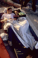 """Inmigrants from Central America in Chiapas, Southern Mexico, before boarding a train in their attempt to reach the US border. They are the poorest persons among the inmigrants, they got to Mexico walking from Honduras, Guatemala or Nicaragua. Once in Mexico they can rest in shelters run by catholic priests before facing the dangerous train travel. In this step, they are often abused by police and gangs that steal the men and rape the women..Una pareja de Honduras descansa en el Albergue para migrantes """"Hermanos en el Camino"""", en Ixtepec, Oaxaca, esperando el siguiente tren para seguir su camino a la frontera norte."""