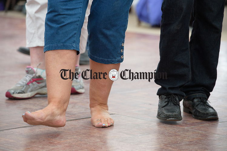 A pupil goes barefoot during a dance class as part of the Willie Clancy Summer school in Miltown Malbay. Photograph by John Kelly.