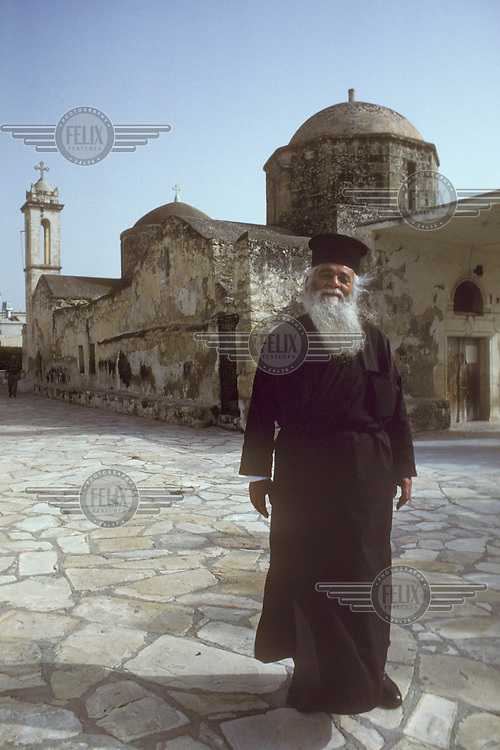 © SB Nace / Panos Pictures..Near Pafos, Cyprus...Priest outside the Empa Greek Orthodox church.