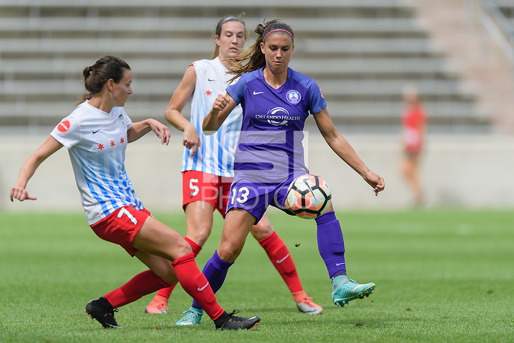 Bridgeview, IL - Saturday July 22, 2017: Taylor Comeau, Alex Morgan, Kathleen Naughton during a regular season National Women's Soccer League (NWSL) match between the Chicago Red Stars and the Orlando Pride at Toyota Park.