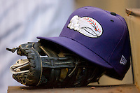 A Winston-Salem Dash cap sits on top of a glove in the home dugout at  BB&T Ballpark April 28, 2010, in Winston-Salem, North Carolina.  Photo by Brian Westerholt / Four Seam Images